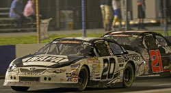 Eric Holmes takes the number 20 Napa powered K&N Pro Series race car across the finish line