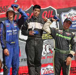 Riverside, California high school student RJ Anderson (left) on the podium after taking second place in LOORRS Race at SpeedWorld Off Road Park, courtesy of JnL Photo