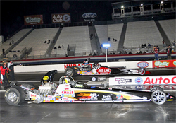 Greg Boutte took the win by half a car length over Rick Beckstrom in Super Comp at the NHRA Finals in Pomona, California, courtesy of Bob Johnson Photography