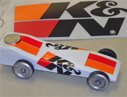 Pinewood Derby vehicle decorated withK&N stickers