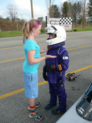 Veteran JR racer Madilyn, giving some last minute advice to the newest drag racer in the family, Adiayn.