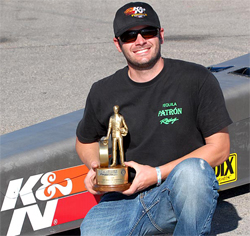 K&N sponsored racer Geoff Nelson with his Wally after his NHRA Top Dragster win in Las Vegas, Nevada, photo by Bob Johnson photography