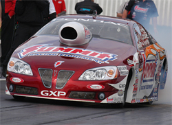 Former NHRA Pro Stock World Champion Greg Anderson broke track records with his 2009 Summit Pontiac at Pomona, California