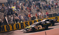 Ty Dillon and Cole Whitt battle it out on the track for the win.