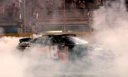 Max Gresham does a burnout at Gresham Motorsports Park after he won his first K&N Pro Series East race of the season.