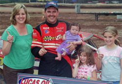 Peggy and Ray Cook with daughters celebrate in the Winner's Circle at Tyler County Speedway in Middlebourne, West Virginia, photo by Todd Turner