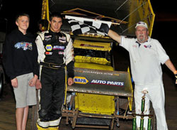The win in Tucson marked the 16-year-old racers third career ASCS Regional win. Pictured next to Hodges is Troy Brubaker; he occasionally helps out when the team races in Tucson.