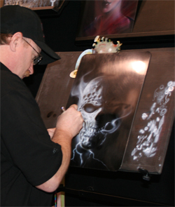 Mike Lavallee demonstrates air brush art in the House of Kolor Booth at the SEMA Show in Las Vegas, Nevada