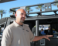 Ryan Hagel of Huntington Beach, California with his modified 1995 Hummer H1 at the SEMA Show at the Las Vegas Convention Center