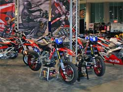 Factory Aprilia bikes on display at Long Beach Convention Center