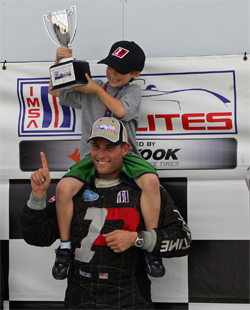 Primetime Team owner and driver Joel Feinberg and son Peter on the podium at Sebring International Raceway