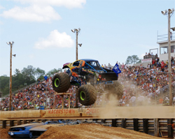 Black Stallion monster truck weighs about 10,000 pounds but still jumps high in front of a packed stadium