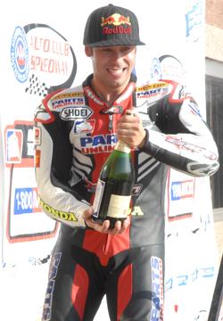Erion's Jake Zemke celebrates his Formula Xtreme victory in the AMA Suzuki Superbike Series