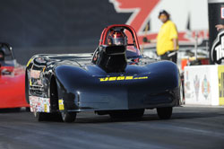 Jason Kenny races along side his father, Alan Kenny in the NHRA Super Comp class