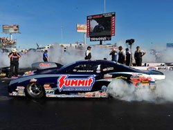 Jason Line drives the Summit Racing Chevy Camaro in the NHRA Pro Stock category