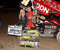 Meyers in victory lane after history making come from behind win (far as we know that's not lady luck next to them)