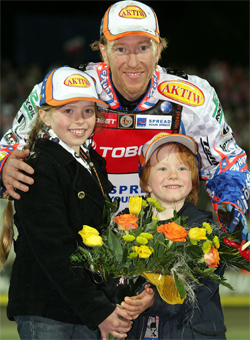 Australian Double World Speedway Champion celebrates victory in Poland with his two children, photo by Mike Patrick