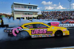 Jeg Coughlin earned a victory at the 26th annual O'Reilly NHRA Spring Nationals in spite of a parachute malfunction.