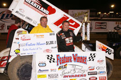 Hull visits victory lane for the 13th time in his career in Sprint Invader Association.  Hull is pictured in victory lane with 34 Raceway Promoter Jeff Laue. Photo by Dana Royer