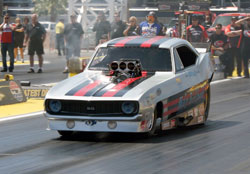 AA/FC National Champion John Hale racing the Nostalgia Funny Car series dragster wrapped in a 1969 Camaro body.