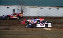 Jon Henry battles it out in his late model car.