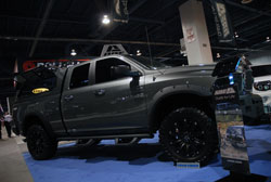 Modified Dodge Ram 1500 in the A.R.E. booth at SEMA 2013