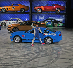 Gittin drove in front of a backdrop of classic Mustangs displayed in rafters like a Matchbox set