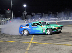Vaughn Gittin Jr., returned to drift action at the Las Vegas Motor Speedway in his repaired 2010 Ford Mustang, photo by John Choi, provided by Falken Tires