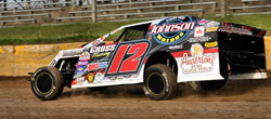 Jason Gross holds the checkered flag at Rice Lake Speedway in the Dirt Modified class