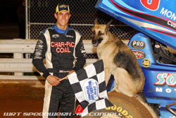 Justin Henderson poses with his mascot after winning a the Season Finale at the Williams Grove Speedway at Mechanicsburg, Pennsylvania.