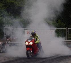 Karme drag racing on her Kawasaki ZX12R