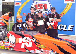 (Left to Right) Crewman Shane Colley, Driver Kathy Fisher, Husband and Teammate Kevin Fisher and 1 yr old Mekoh, celebrate the IHRA Quick Rod final for the K&N Engineering ride in Martin, MI
