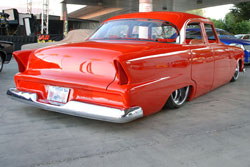 The bright red paint on Kent Ladners 1955 Plymouth Belvedere drew SEMA fans for a closer look.