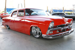 What catches your attention after the paint job is that the SEMA 1955 Plymouth Belvedere appears to rest on the ground.