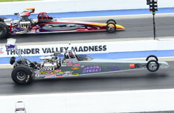 During Fisher's final qualifying pass, he carried the wheels to a 4.251 and expanded his spread on the Top Dragster field.