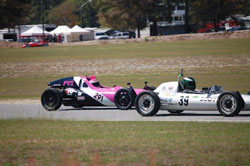 Kim Madrid driving the hot-pink Formula Vee, and sporting her trademark pink Mohawk helmet, won the race in Georgia.