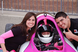 Madrid's daughter Dana and future Formula Vee racing star, son Chris, give the thumbs-up for mom's latest championship win.