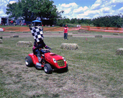 Cutting blades are removed on the lawn mower racing circuit, there are no cash prizes and racers compete for bragging rights