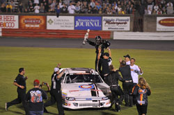 Corey LaJoie and his team celebrating their victory.