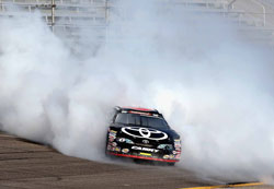 Kyle Larson lights the tires up in celebration after winning the 2012 Pro Series East Chamionship