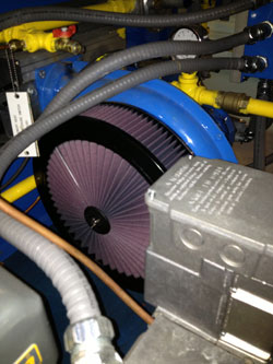 Ron D.R. Laing unconventional use of a K&N air filter has reduced maintenance and improved the life of their washer/blower system by more than 50%.