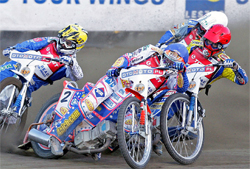 Double World Speedway Grand Prix Champion Jason Crump leads Russia's Emil Sayfutdinov and Denmark's Kenneth Bjerre in Poland