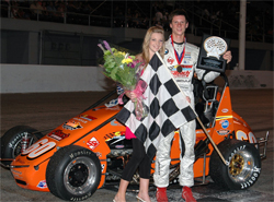 Driver Michael Lewis steps in Victory Lane after winning the USAC California Pavement Ford Focus Series event, photo by Mary S. Secord