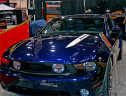 2010 Ford Mustang GT with a 4.6 liter supercharged engine in the Procharger booth at the SEMA Show in Las Vegas, Nevada