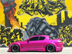 The candy pink exterior paint of Lina Rodriguez's 2004 Mazda RX-8 demands your attention no matter where it's at.