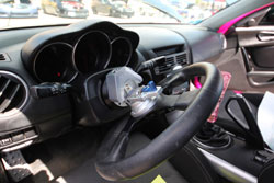 Lina Rodriguez equipped her 2004 Mazda RX-8 with a quick release NRG Steering wheel.