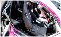 "Lina Rodriguez's Mazda RX-8 sports Sparco Racing Seats and Harness, Kicker 10"" subwoofers and much more."