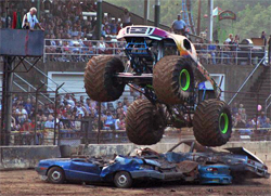 Freestyle action during Monster Truck Competition had high speed, big air and non stop action