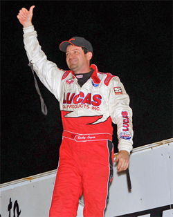 Ricky Logan took home a trophy, a check, half an pig and half a cow after winning a sprint car race during the Marion County Fair in Knoxville, Iowa, photo by DaveHillsRacingImages.com