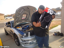 With K&N Ford Mustang GT air intake in hand, Louie Bustillos shows us how much he loves performance.